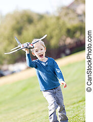 child playing with a plane