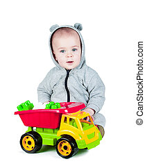 child playing with a toy truck