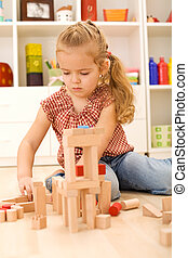 Child playing with blocks on the floor