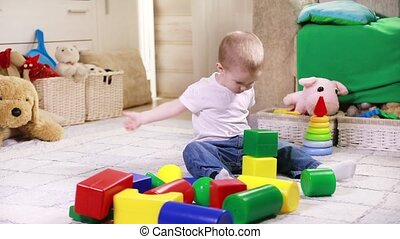 Child playing with color blocks - Playful little boy plays...