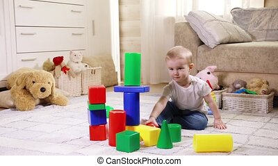 Child playing with construction blocks - Little Caucasian...