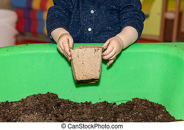 Child playing with dirt