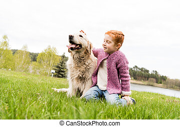 child playing with dog
