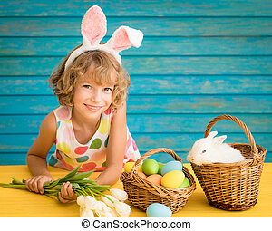 Child playing with Easter bunny
