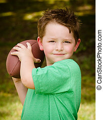Child playing with football outdoor
