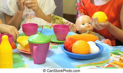Child playing with plastic tableware. Close up