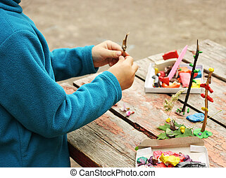 Child playing with plasticine.