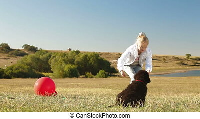 Child Playing With Puppy - Little Blond Girl Playing With...