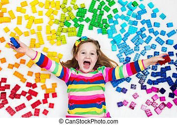 Child playing with rainbow plastic blocks toy - Funny little...