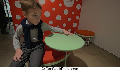 Child playing with rotating table in HAM hall, Helsinki
