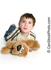 Child playing with stuffed toy