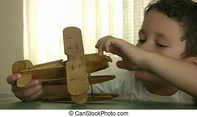 Child playing with toy airplan