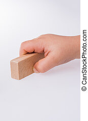 child playing with wooden building blocks