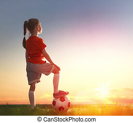 Child plays football - Cute little child dreams of becoming...
