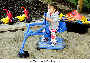 Child plays in a playground - Child plays with a miniature ...
