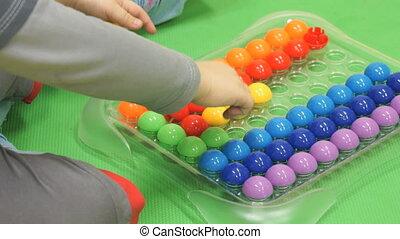 Child plays intellectual games in kindergarten - Child plays...