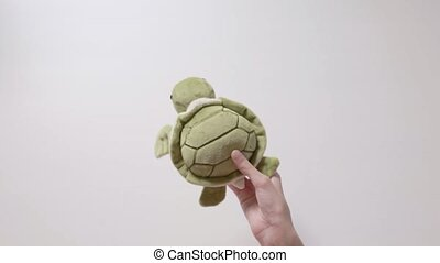 Child plays with a turtle toy. Part_06.