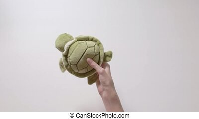 Child plays with a turtle toy. Part_07.