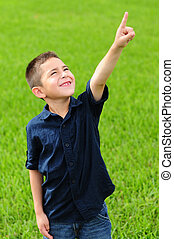 Child pointing up at sky
