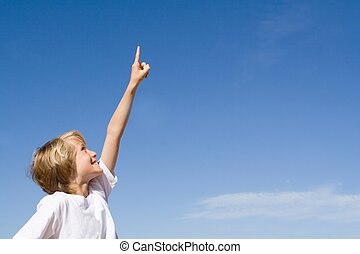 child pointing up to copy space