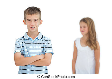 Child posing while his sister looking at him