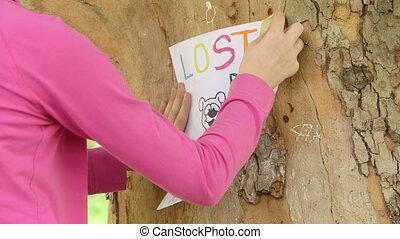 Child posting missing pet poster