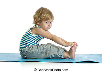 Child practicing yoga, stretching in exercise wearing sportswear. Kid isolated over white background