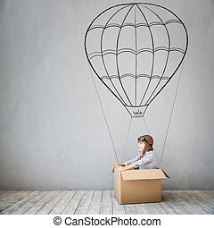 Child pretend to be businessman. Kid playing at home. Imagination, idea and creative concept