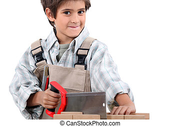 Child pretending to be a grown-up carpenter
