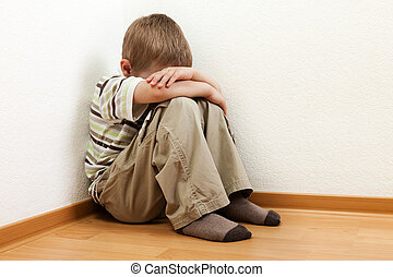 Little child boy wall corner punishment standing