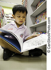 Child reading a book.
