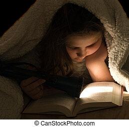 Child Reading In The Dark