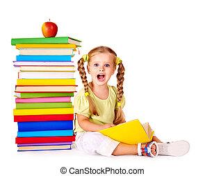 Child reading  pile of books.