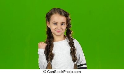 Child rejoices in victory. Green screen