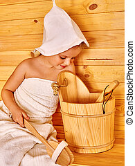 Child relaxing at sauna.