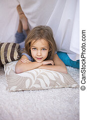 Child resting on comfortable pillows
