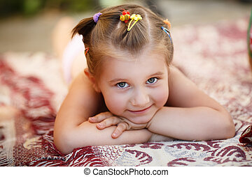 Child resting outdoors