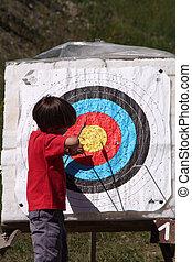 child retrieving arrow