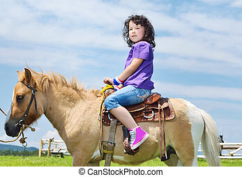 child ride pony - happy child ride farm animal brown pony...