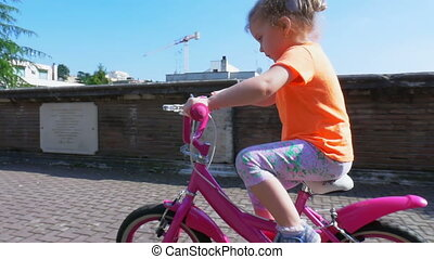 Child riding a bicycle on a sunny day