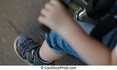 Child riding a bike fast