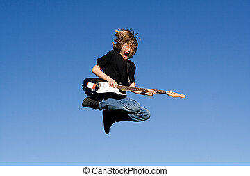 child rock guitar player and singer