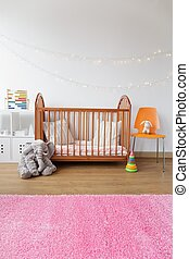 Child room with wooden crib