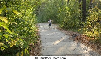 child running along a path in a park