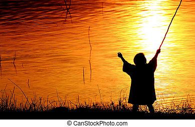 Child running at sunset