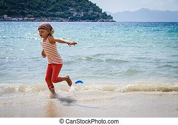 child running in water