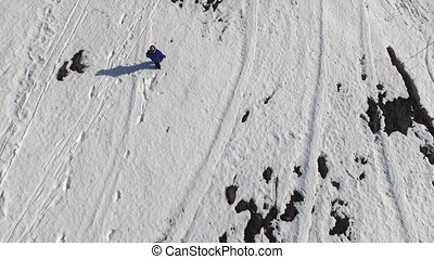 Child running on a snow field