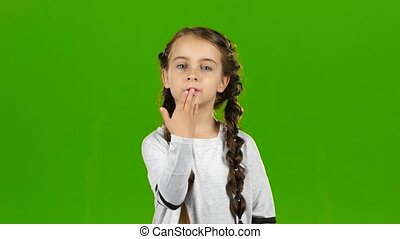 Child sends an air kiss. Green screen - Child sends air...