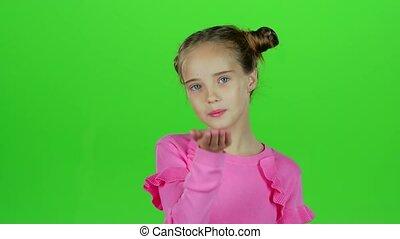 Child sends an air kiss. Green screen. Slow motion - Child...