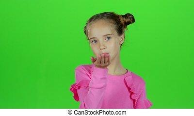 Child sends an air kiss. Green screen - Child sends an air...